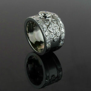 DF 7 - 14K white gold tapered band with bezel, channel and flush set diamonds.