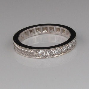 B 6 - 14K white gold anniversary band with diamonds and hand engraving.