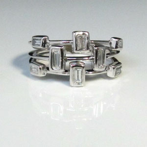 B 10 - 14k white stacking rings with bezel set baguette diamonds.