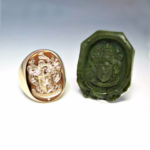 G 14 - 14K yellow gold hand engraved crest ring with wax relief.