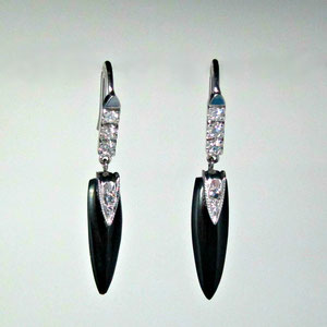 E 87 - 14K white gold earrings with black onyx dangles and diamonds.