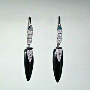 E 87 - 14K white gold earrings with black onyx dangles and diamonds.