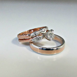 WF 19 - 14K rose and white gold wedding set with matching Gts. band.
