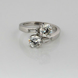 DF 16 -  14K white gold bypass ring with two round diamonds and two baguette diamonds.