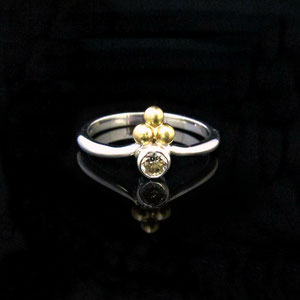 DF 35 - 14K white gold ring with bezel set diamond and yellow gold balls.