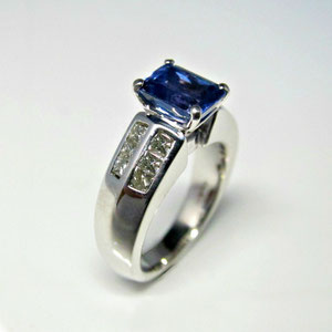CS 34 - 14K white gold ring with channel set square diamonds and emerald cut tanzanite.