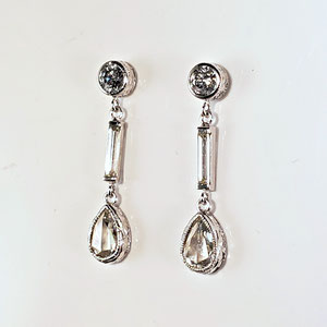 E 100 - 14K white gold dangle earrings with round diamonds, baguette diamonds, and pear shaped rose cut diamonds.