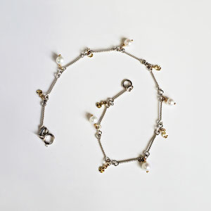 BR 10 - 14K white gold  twist bar bracelet with pearls and yellow gold dangles.