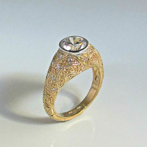 DF 20 - 14k two tone granulated diamond ring.