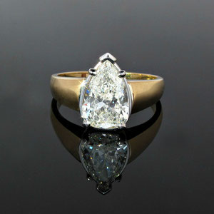 DF 12 - 14K two toned gold ring with pear shaped diamond.
