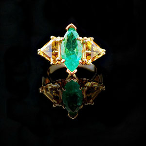 CS 40 - 14K yellow gold ring with center marquise shaped emerald and two triangle citrines.