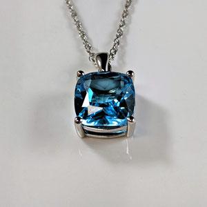 P 112 - 14K white gold pendant with cushion cut blue topaz.