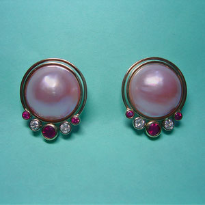 E 26 - 14K two tone gold earrings with pink mabe pearls, diamonds, and rubies.
