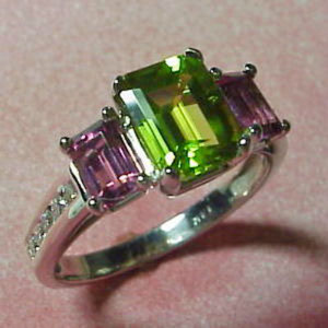 CS 13 - 14K white gold ring with peridot, pink tourmaline, and channel set diamonds.