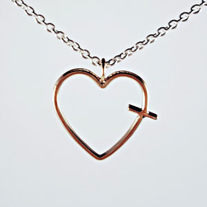 P 62 - 14K rose gold heart shaped pendant with cross.