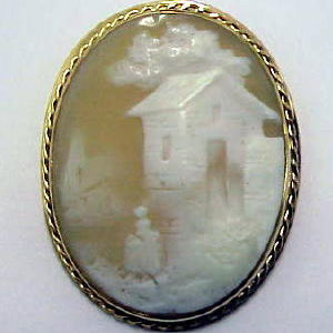 PB 20 - 14K yellow gold pin with cameo.