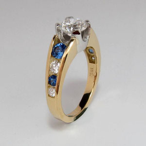 DF 29 - 14K two toned ring with center diamond and channel set diamnonds and sapphires.