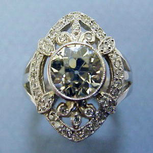 DF 22 - 14K white gold antique reproduction ring with center old European cut diamond and melee diamonds.