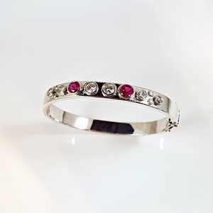 BR 13 - SS bangle bracelet with bezel set rubies and diamonds.