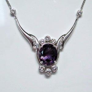 P 24 - 14K white gold pend with oval amethyst and diamonds.