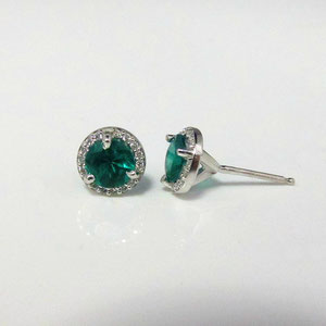 JS 15 .1 - 14K white gold earrings with center emerald surrounded by diamonds.