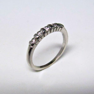B 20 - 14K white gold band with bar set diamonds.
