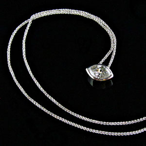 P 96 - 14K white gold pendant with marquise shaped diamond.
