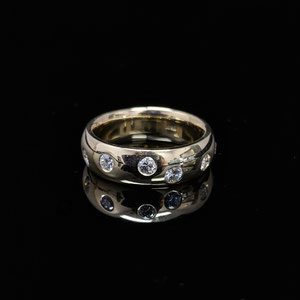 B 26 - 14K yellow gold band with diamonds.