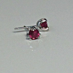 E 3 - 14K white gold earrings with rubies.