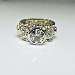 DF 33 - 14K two tone band with bezel set diamonds and twist wire border.