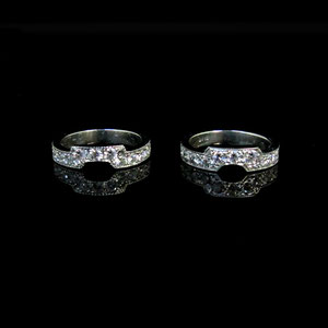 B 15 - Platinum bead set diamond conture bands.