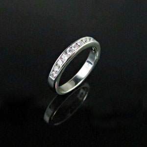 B 12 - 14k white gold diamond channel band.