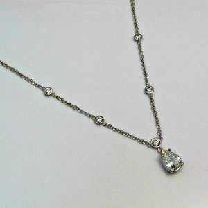 P 58 - 14K white gold necklace with bezel set diamonds and a pear shaped diamond.