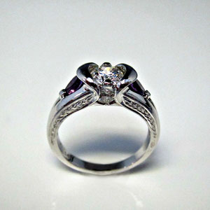 DF 31 - 14K white gold ring with center diamond, side diamonds, and pear shaped amethysts.