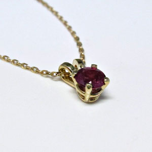 P 57 - 14K yellow gold  basket style pendant with rhodolite garnet.