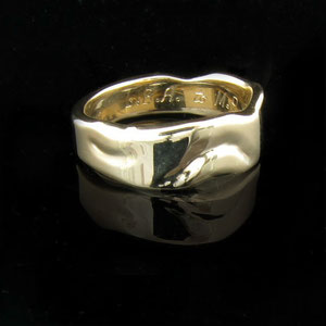 B 7 - 14K yellow gold custom designed wedding band.