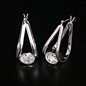 E 107 - 14K white gold earrings with oval diamonds.