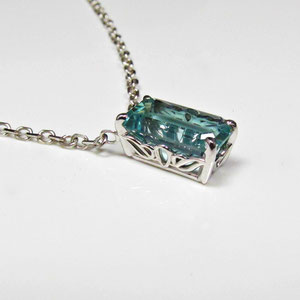 P 77 - 14K white gold scroll setting with emerald cut aquamarine.