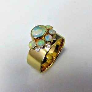CS 42 - 14K yellow gold ring with bezels set opals and gypsy set diamonds.