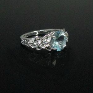 CS 5 - 14K white ring gold with center aquamarine and side diamonds.