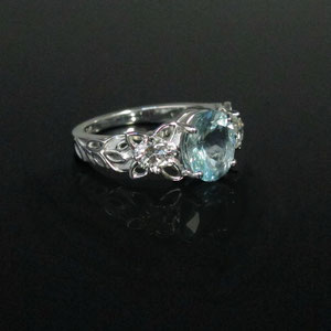 CS 5 - 14K white ring gold with center aquamarine and side diamonds.