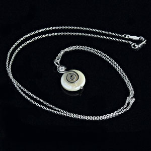 P 40 - 14k white gold pendant featuring a coinpearl and accented with a bezel set diamond.