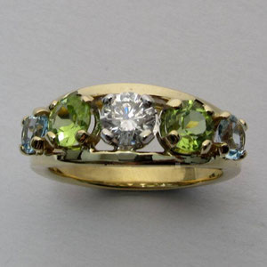 CS 3 - 14K two toned gold ring with diamond, peridots, and blue topaz.