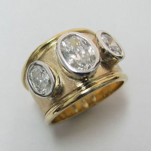 DF 9 - 14K two toned gold  wide band with three bezel set oval diamonds.