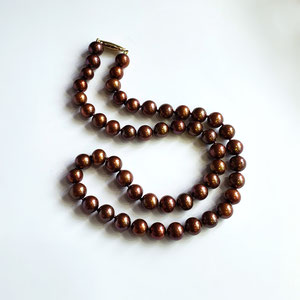 """P 118 - 18"""" chocolate pearls with 14k yellow gold clasp."""
