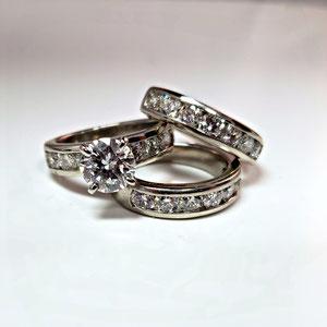 WF36 - Platinum wedding set with center diamond and channel set diamonds.