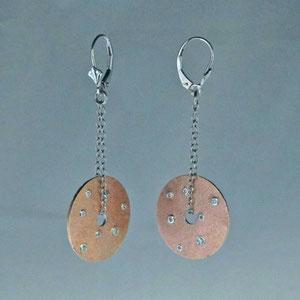 E 85 - 14K pink and white gold dangle earrings with bezel set diamonds.