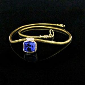 P 92 - 18K yellow gold bezel set tanzanite pendant on customer's chain.