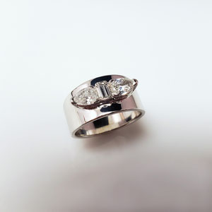 DF 47 - 14K white gold ring with emerald cut and pear shaped diamonds.