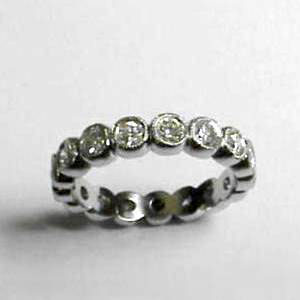 B 11 - 14k white bezel set diamond eternity band.
